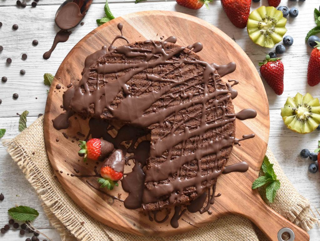 Flatlay of the Best SugarFree Flourless Chocolate Cake with fruit