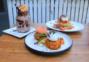 A variety of dishes at Rock Paper Scissors in Port Melbourne including freakshake, pancakes, and rosti.