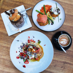 Rock Paper Scissors breakfast spread featuring hot cakes, coffee, nutella freakshake, and potato rosti