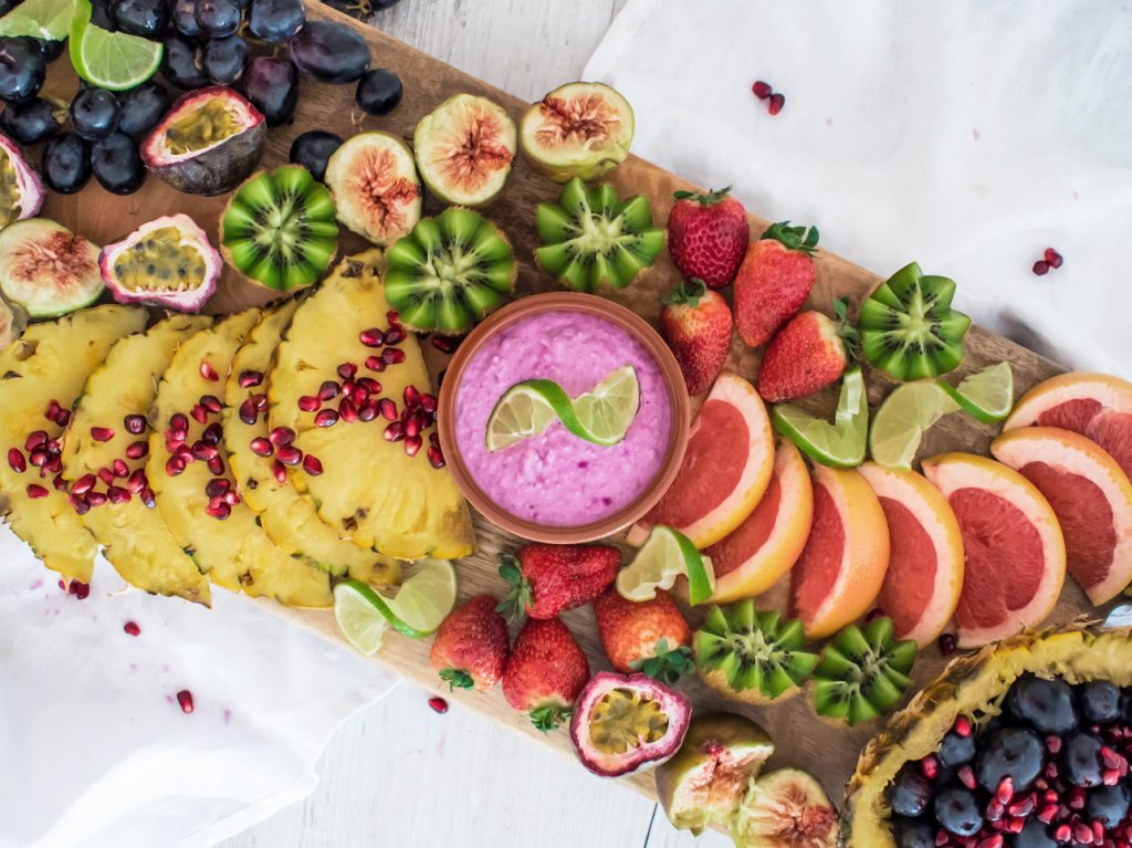 Pitaya, Lime & Chia Dip served with a variety of tropical fruit