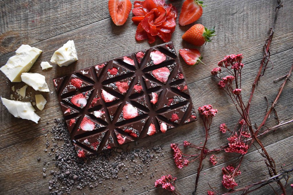Creamy Vegan Dark Chocolate with freeze dried strawberries and cacao nibs