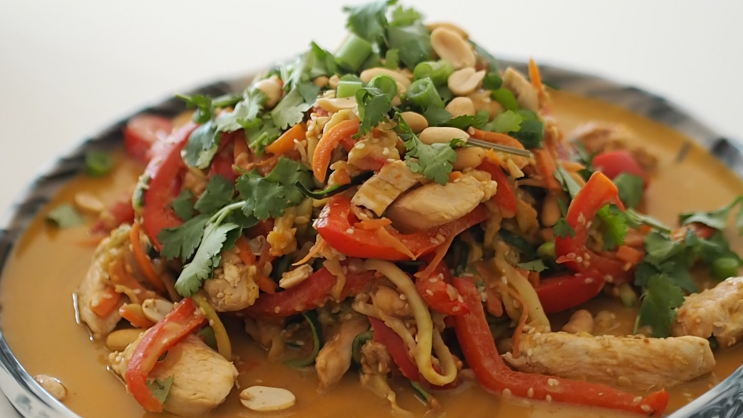 Chris Nayna's Chicken Satay Zoodle high protein recipe